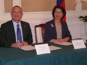 Signing an MOU as Executive Dean at the Taiwan Embassy in 2014